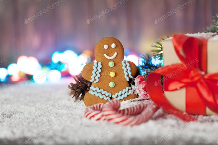 Christmas gift box, candy canes and gingerbread man