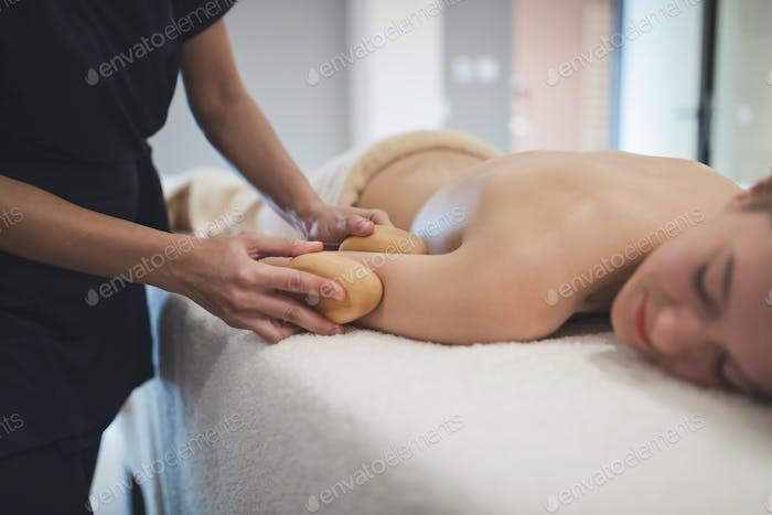 Cliend enjoying massage given by masseur