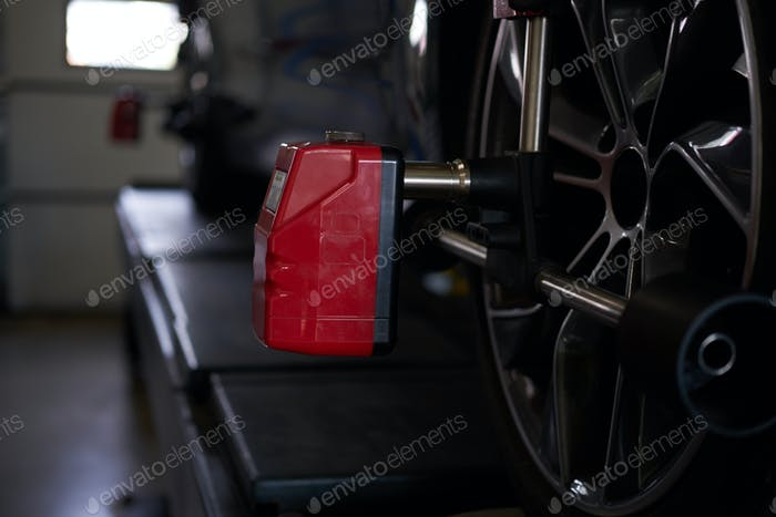 Balancing of car's tyres at auto workshop