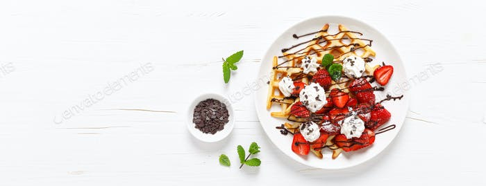 Belgian waffles with fresh strawberry, chocolate topping and whipped cream. Banner