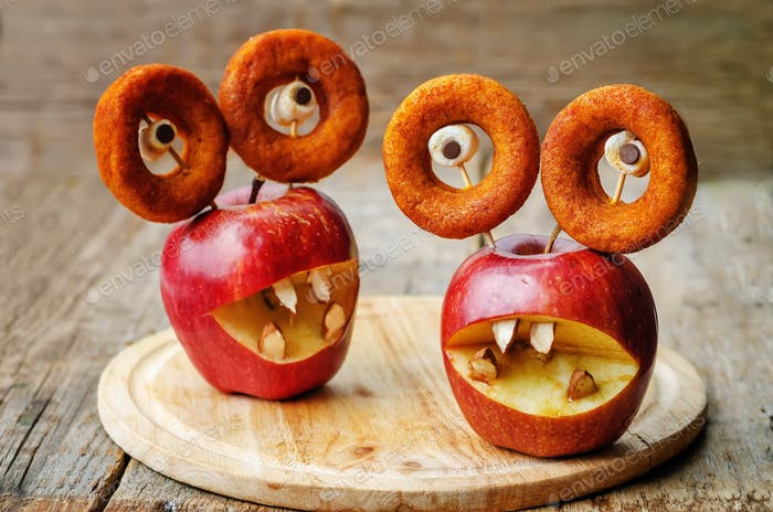 apples, marshmallows and donuts in the shape of monsters for Hal