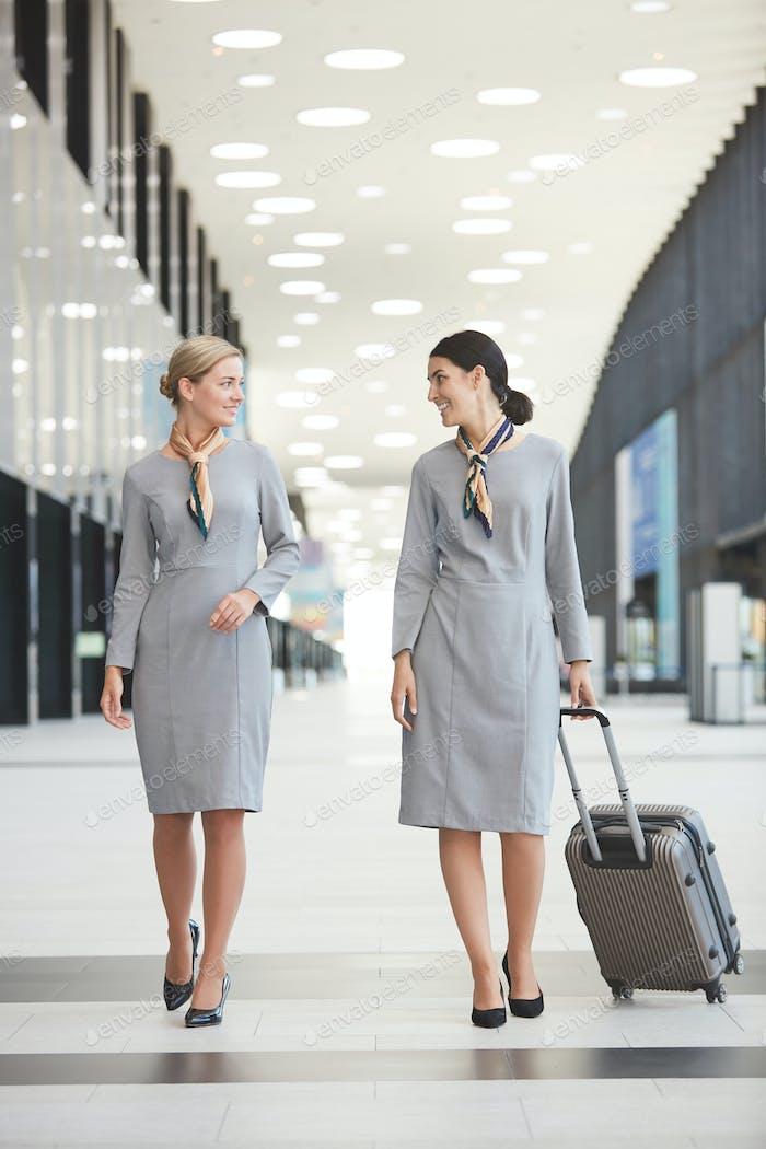 Flight Attendants Walking in Airport