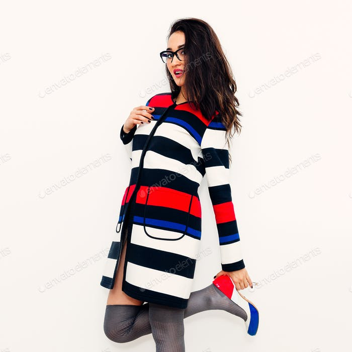 Brunette Girl in fashion striped coat and stylish Shoes. Lady  S
