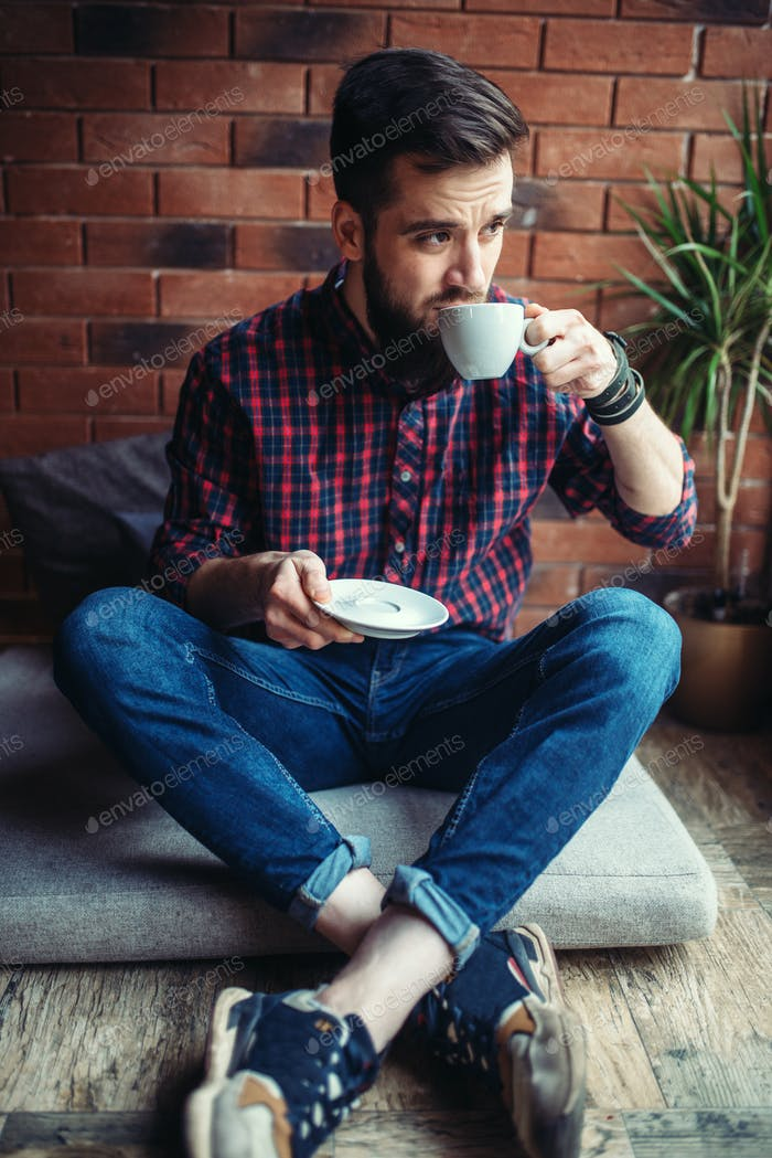 One male visitor sitting in coffee house