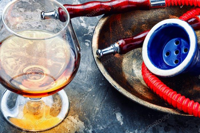 Smoking hookah with brandy flavor