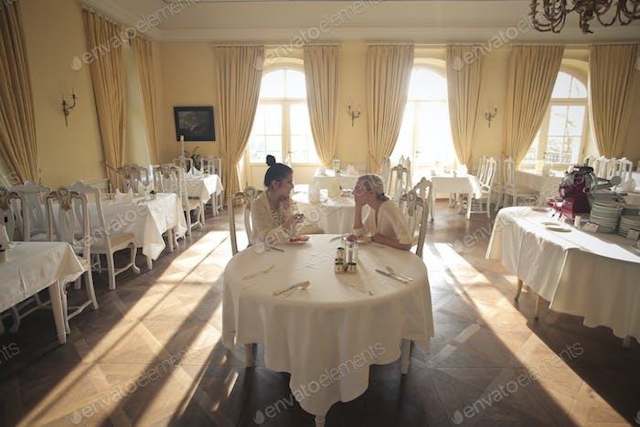 Two girls in an elegant restaurant
