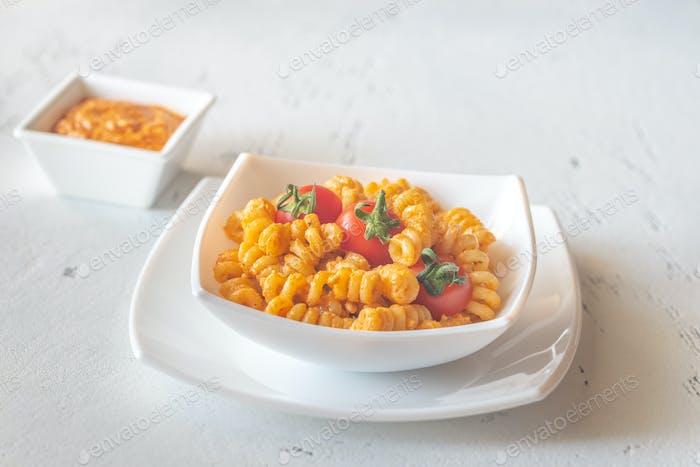 Portion of pasta with tomato and ricotta pesto