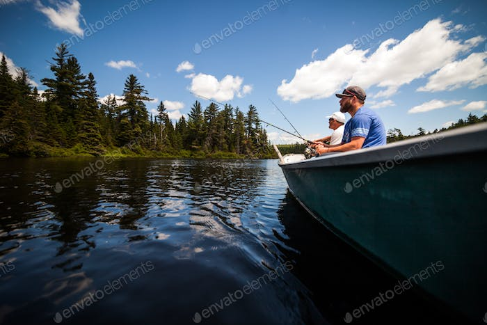 Sun and Father Fishing in a Calm Lake in Wild Nature.