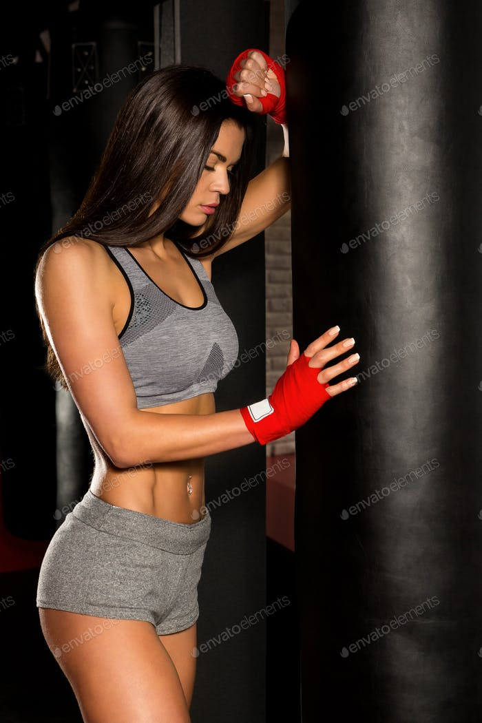 Beautiful female workout functional training.