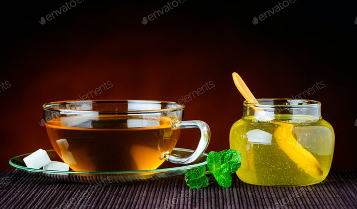 Tea Cup and Glass Of Honey