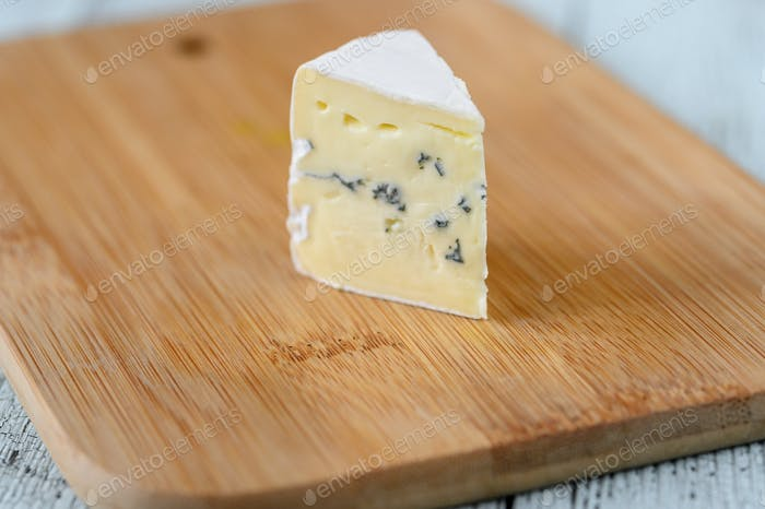 Blue cheese with white mould