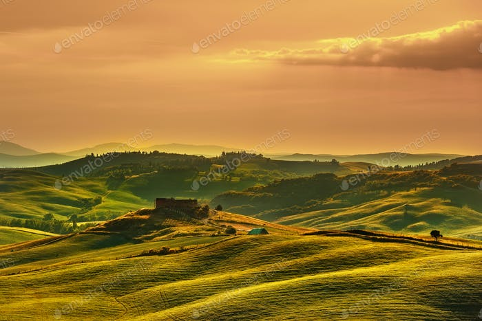 Tuscany spring, rolling hills on sunset. Volterra rural landscap