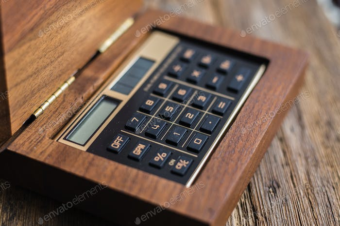 Calculator closeup on wooden background