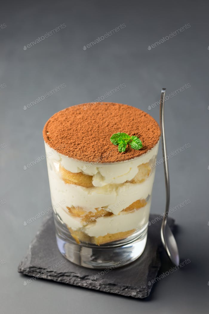 Traditional italian Tiramisu dessert cake in glass, decorated wi
