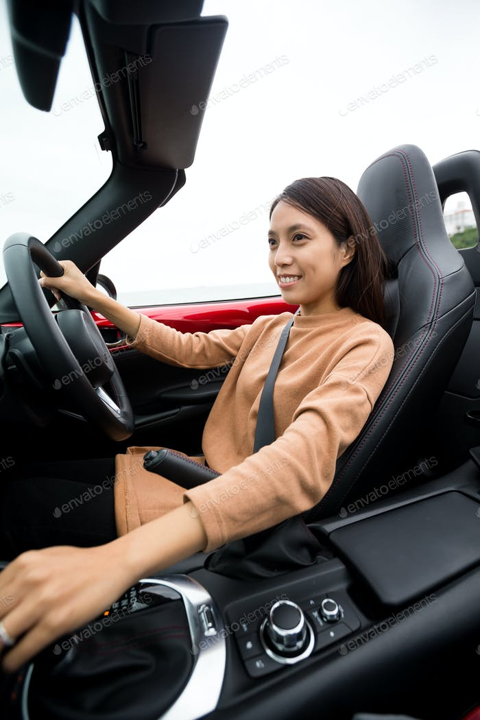 Girl driving convertible