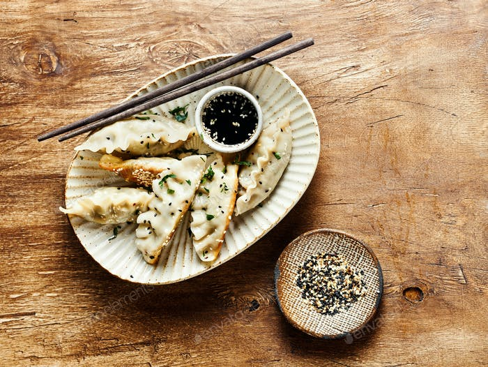 Fried dumplings with herbs and sesame