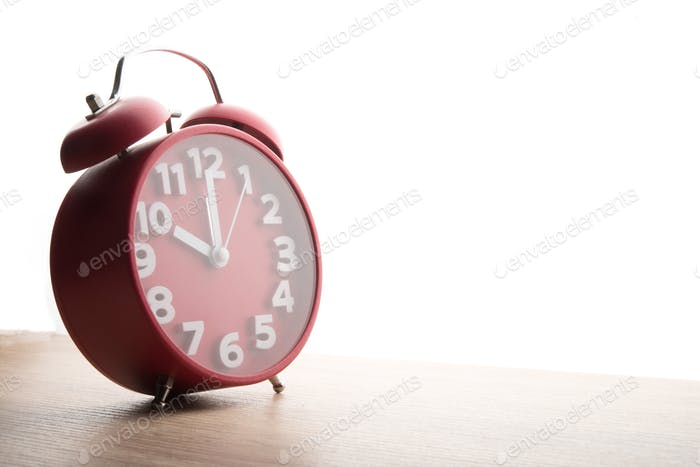 Red alarm clock isolated on white background. Business time concept.