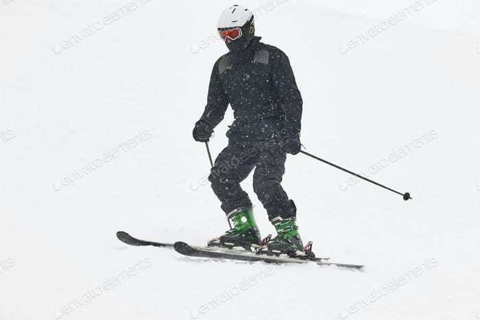 Skier under the snow. Winter sport. Ski slope. Horizontal