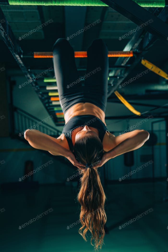 Woman on boxing training doing crunches
