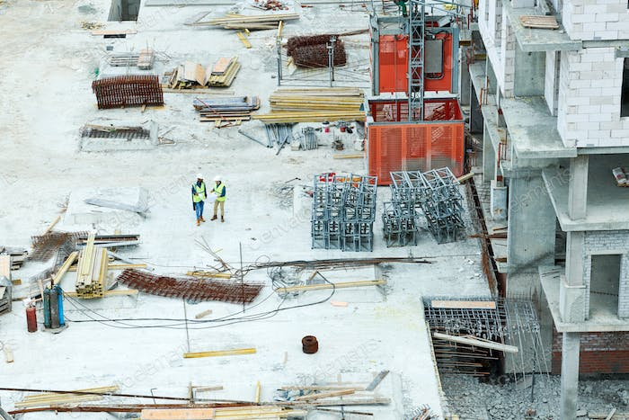 Modern construction site with stacks of building materials