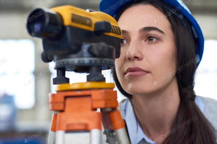 Woman Working in Construction Surveying