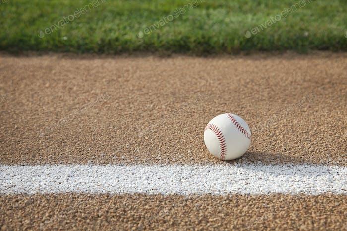 Baseball on Gravel Base Path with White Stripe