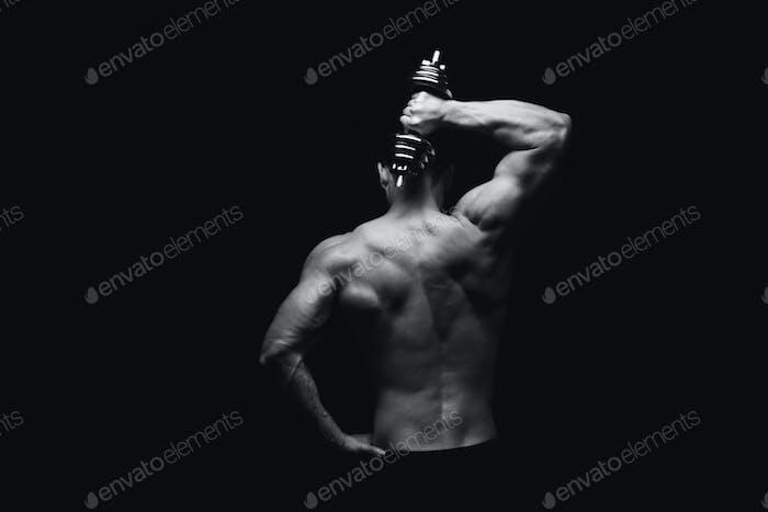 Unrecognizable man shows strong back muscles closeup