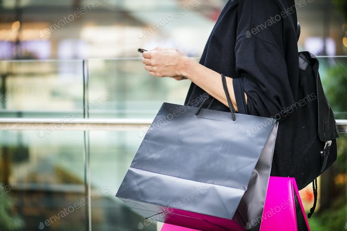Girl carrying a alot of shopping bags
