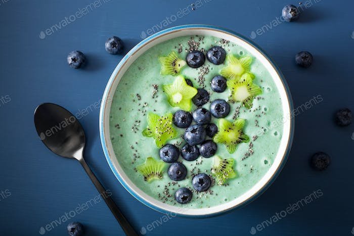 healthy spirulina smoothie bowl with blueberry, kiwi stars, chia