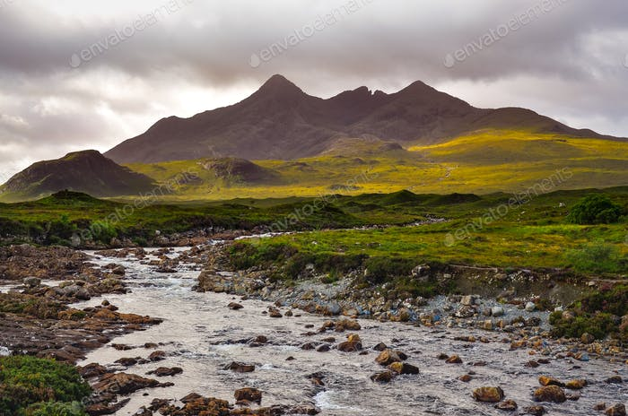 Dramatic landscape of Cuillin hills and river, Scottish highland