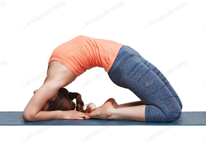 Beautiful sporty fit yogi girl practices yoga asana Kapotasana