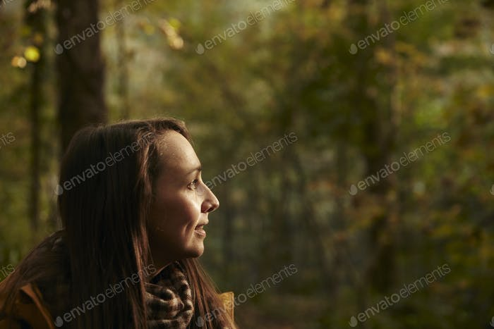 Portrait of woman in woodland