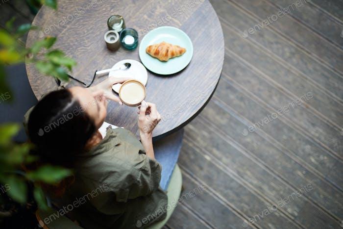 Having breakfast in coffee shop