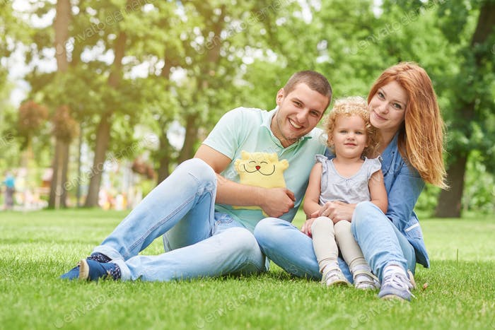Happy young family relaxing at the park