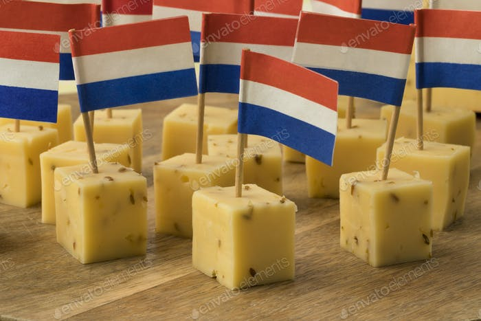Pieces of traditional Dutch cumin cheese as a snack