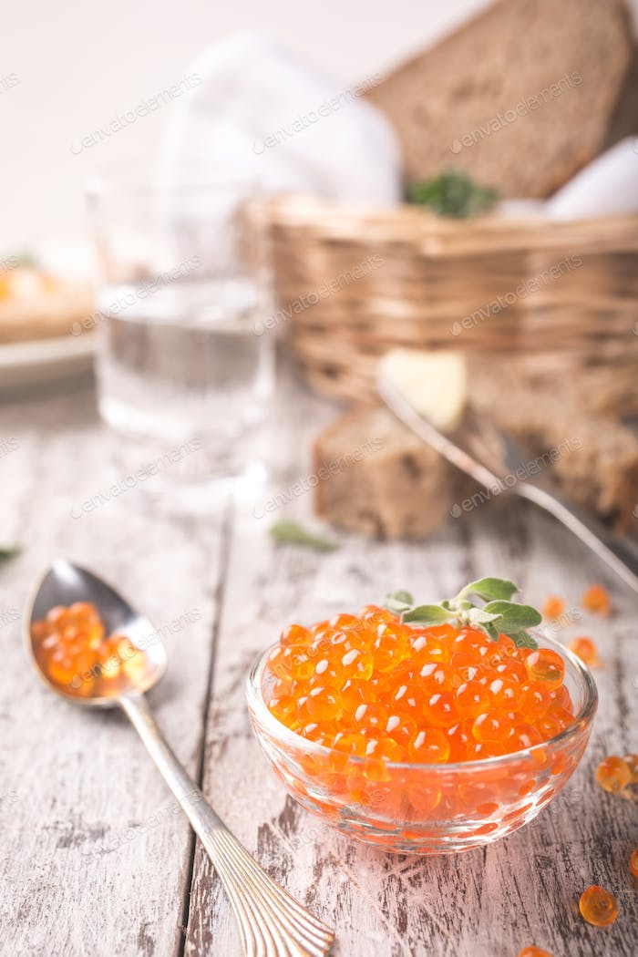 Glass bowl with red caviar