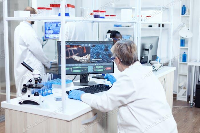 Senior scientist in pharmaceuticals laboratory doing genetic research