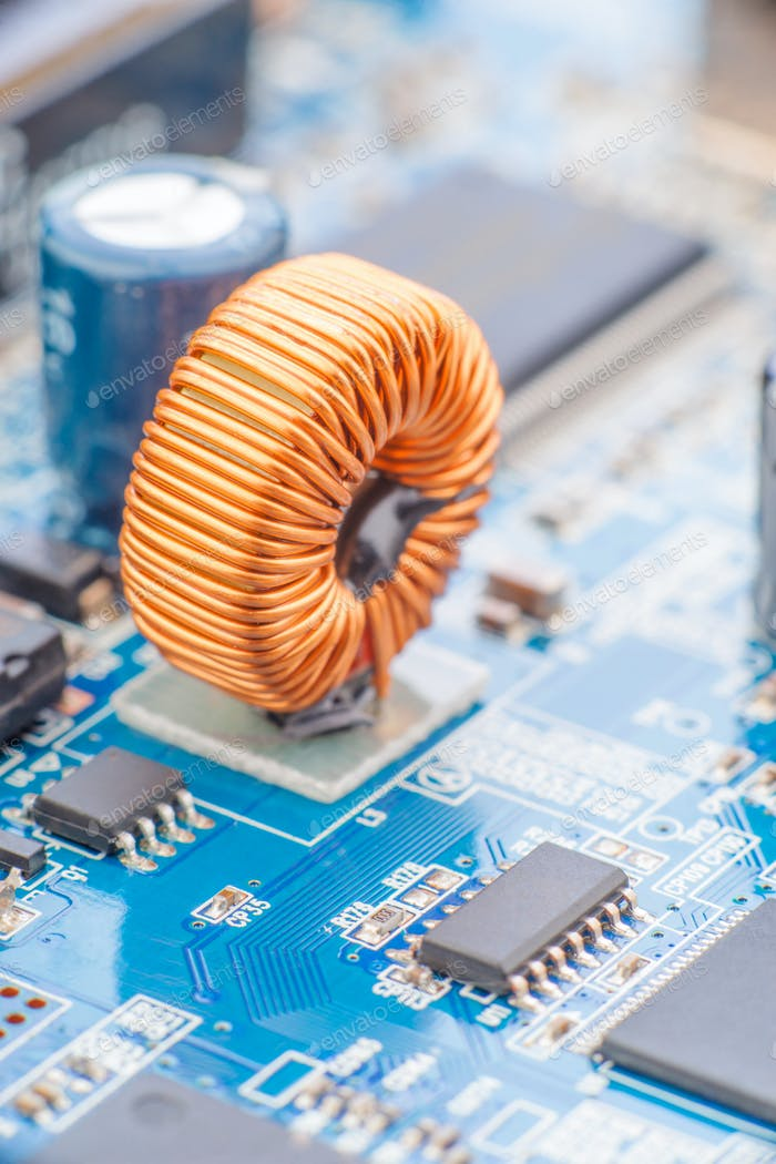 golden reel mounted electronic circuit board, macro shot