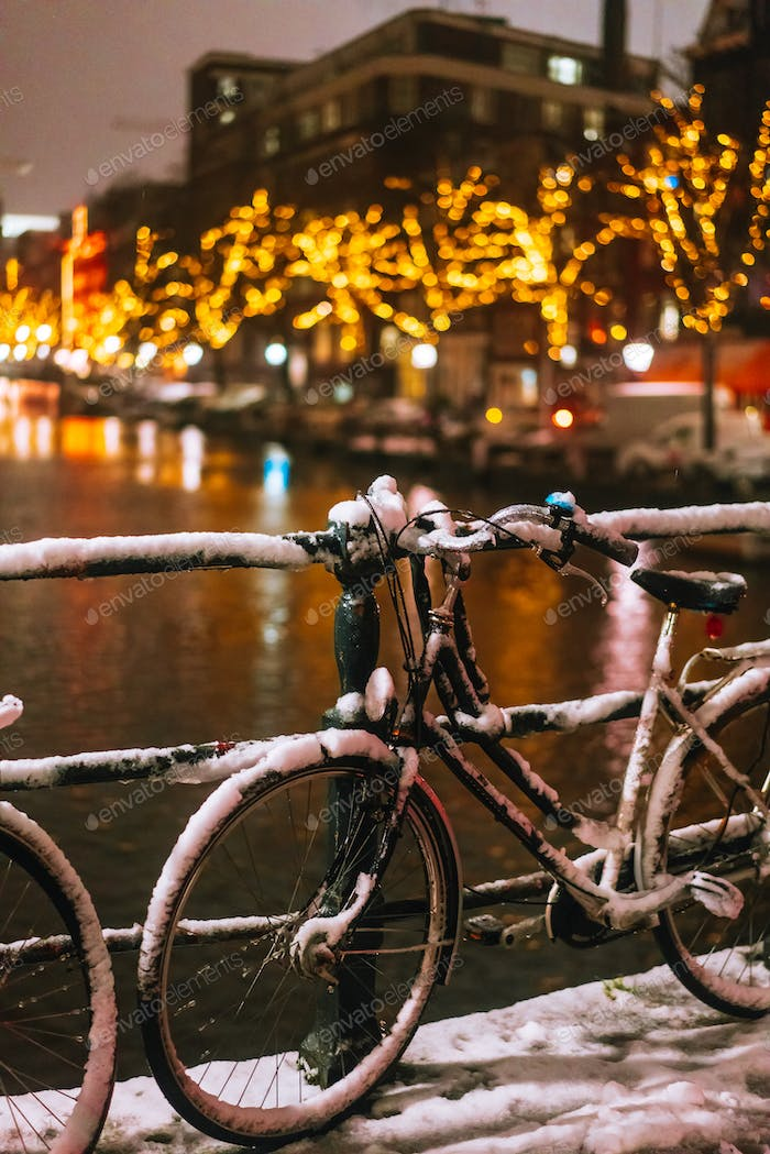 Bicycles Parked Along a Bridge Over the Canals of Amsterdam