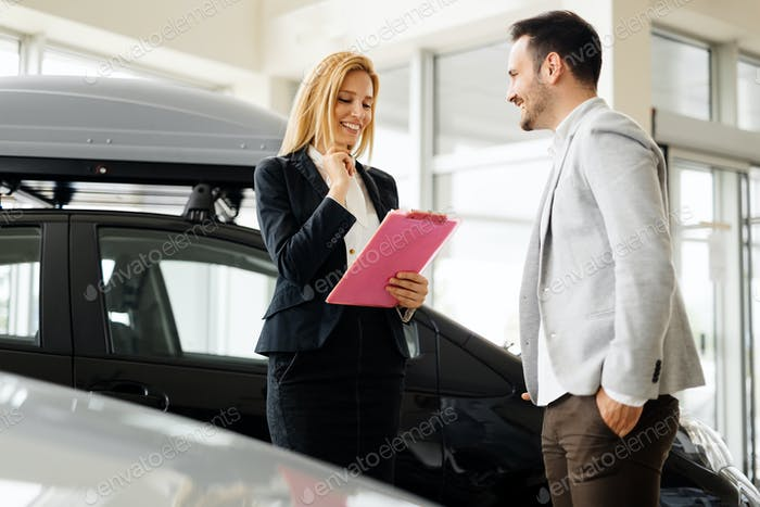 Professional salesperson selling cars