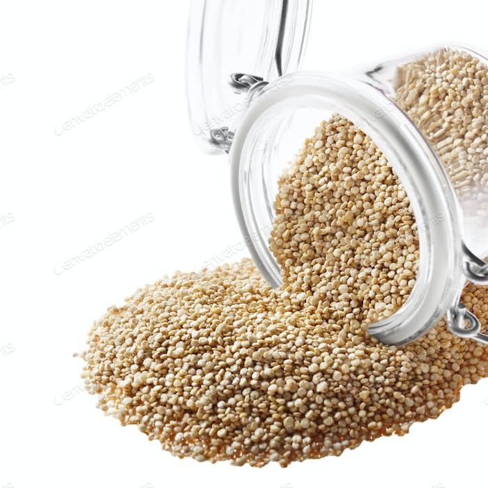 Raw organic superfood gluten free quinoa seeds in airtight glass