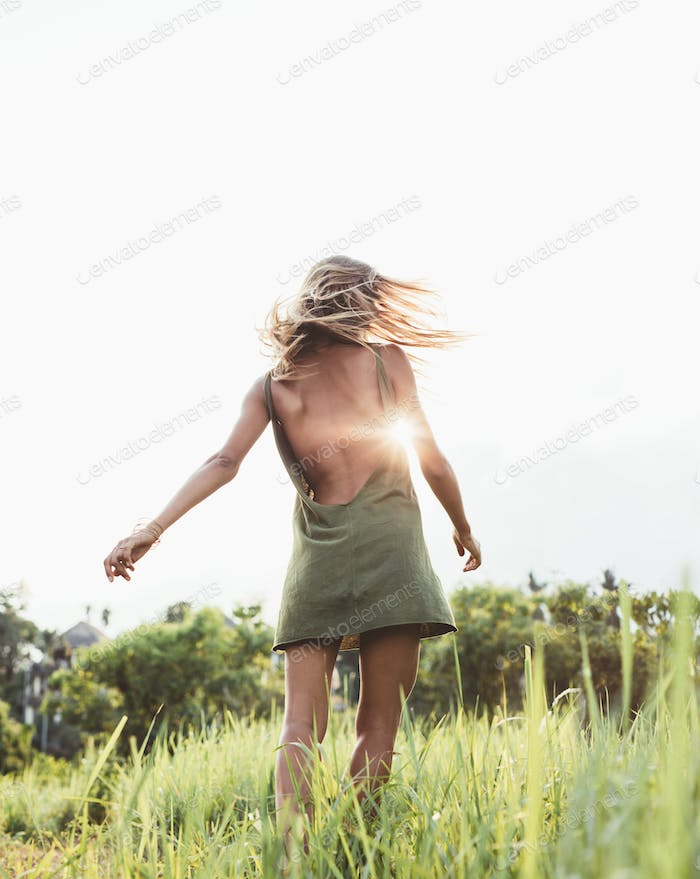 Young woman in summer field