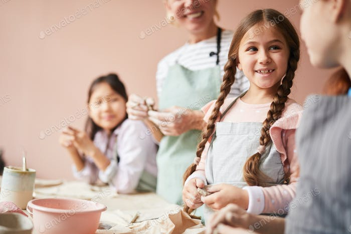 Cute Girl in Pottery Workshop