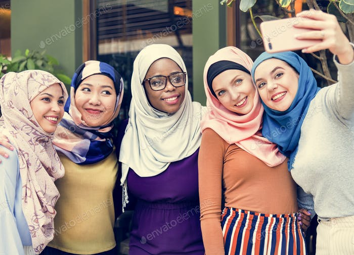 Islamic women friends taking selfie together