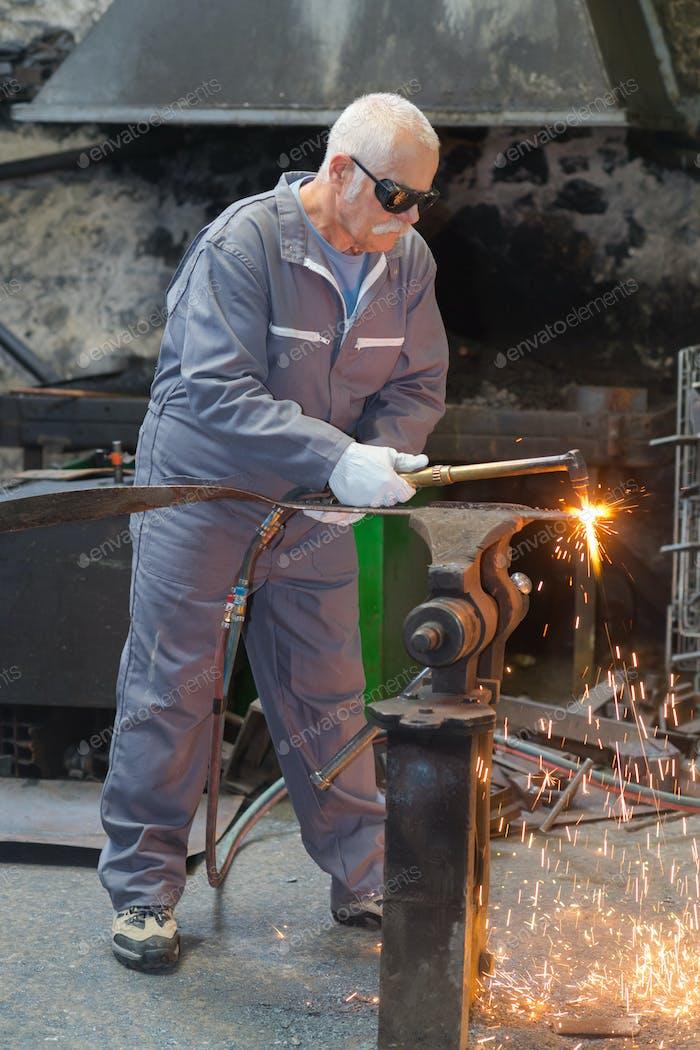 senior man working in the metallurgy industry