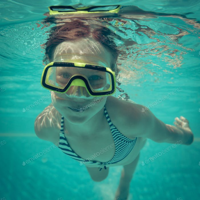 Underwater portrait of happy child