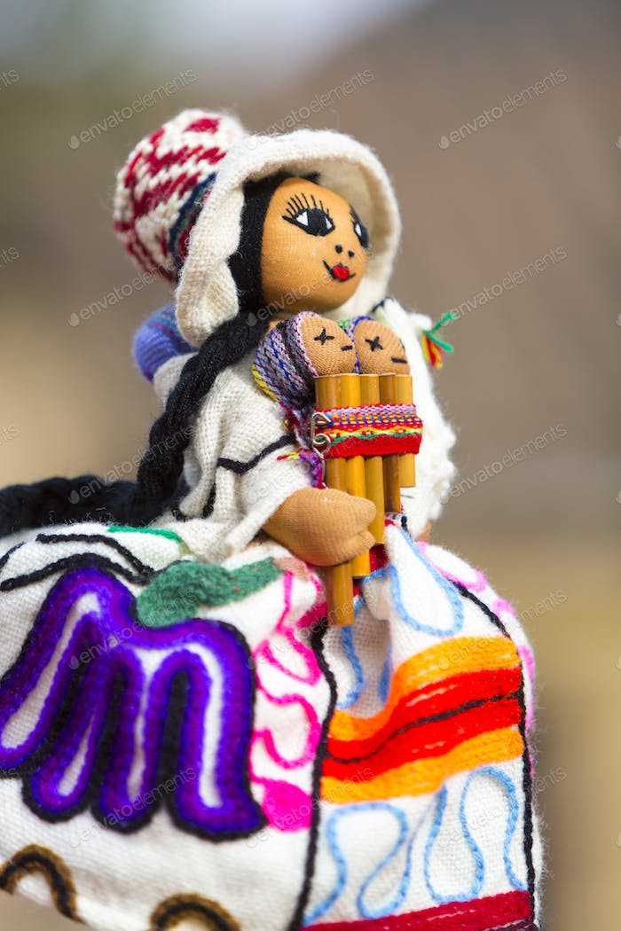 Colored colored puppet isolated on blurred background in Cusco