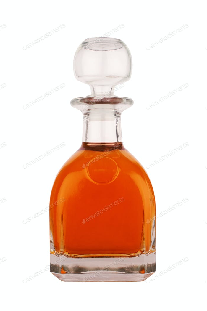 liqueur or whisky glass bottle isolated on white