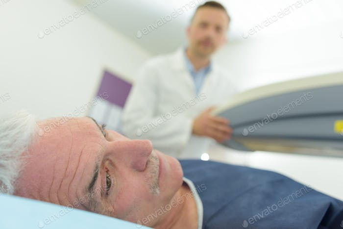 worried man doctor analyzing male patient with ultrasound