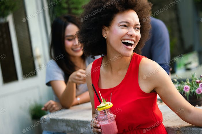Group of friends having fun together. People talking laughing and enjoying their time